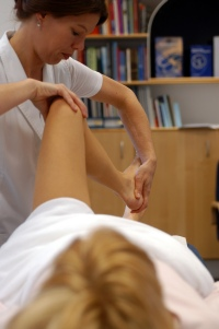 Osteopath treating young woman